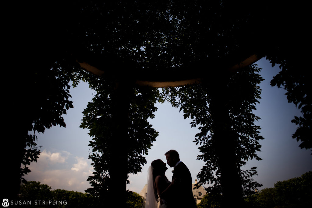 bride and groom in gardens at oheka castle