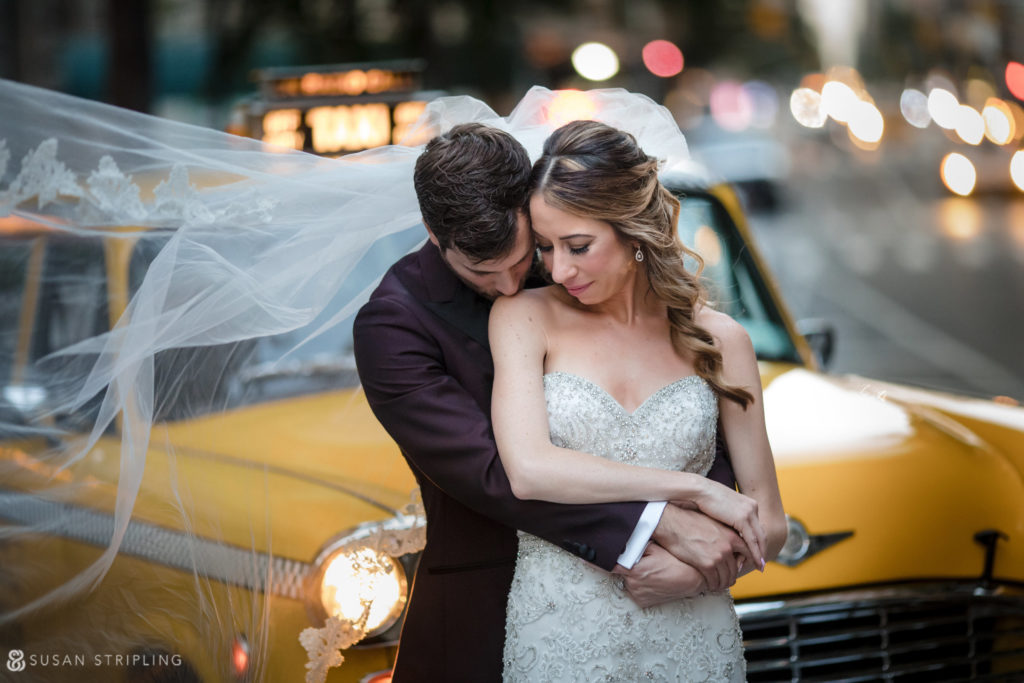 gramercy park hotel wedding picture of a bride and groom with a vintage cab at sunset