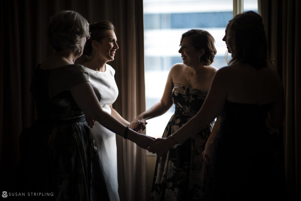 bride getting ready with her mother and sisters at the westin in philadelphia