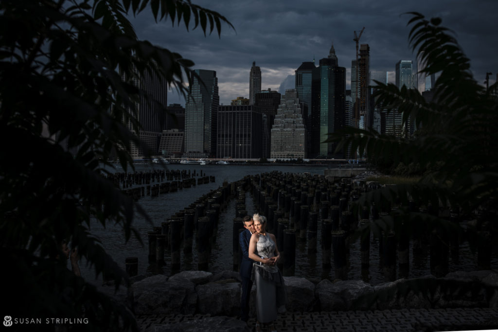 wedding photo with brooklyn bridge park pylons