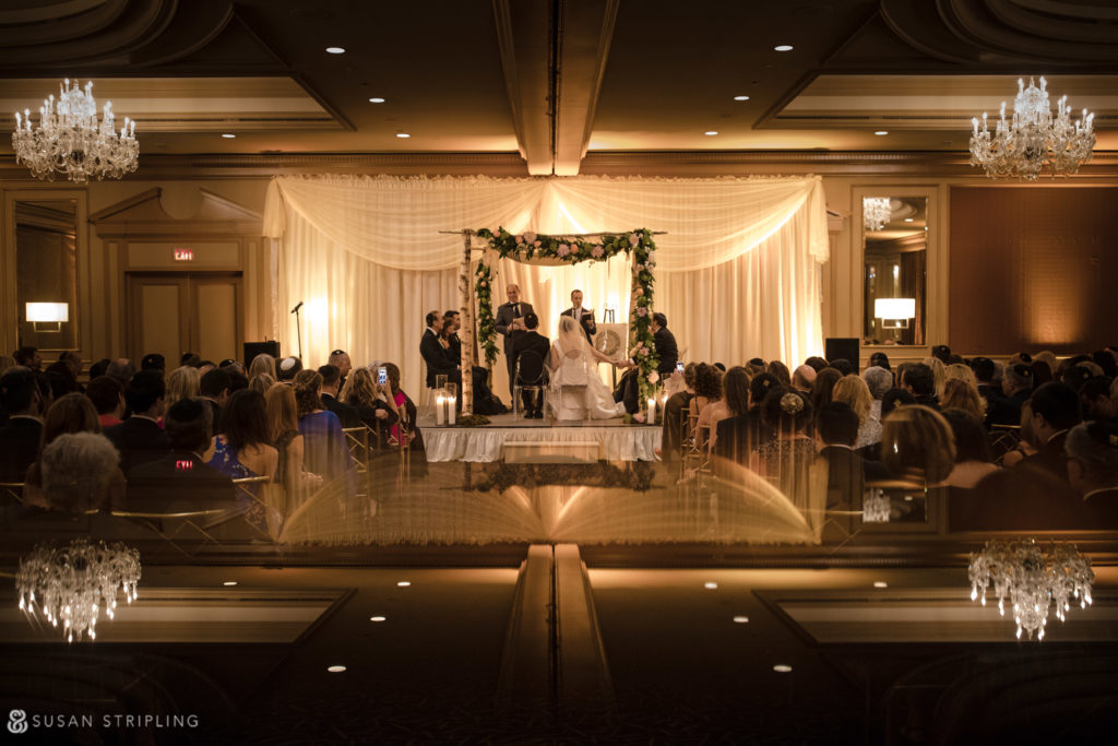 dramatic ceremony decor in philadelphia for a jewish wedding
