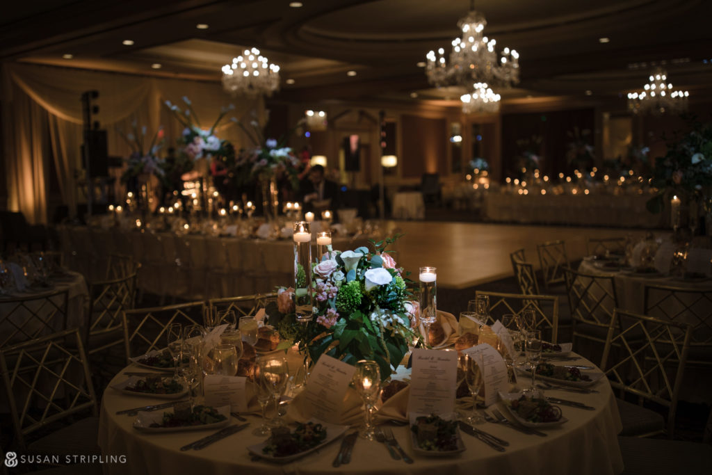 carl alan florist wedding reception decor with low flowers on round tables