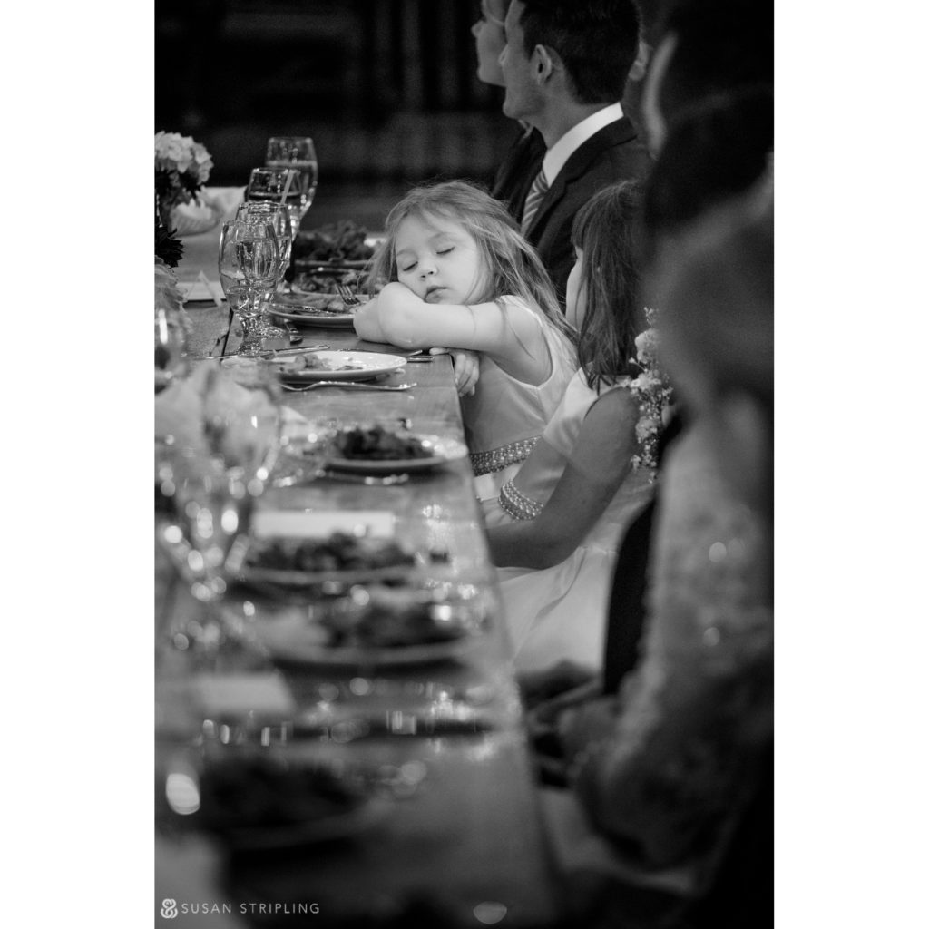 flower girl asleep at table wedding reception riverside farm