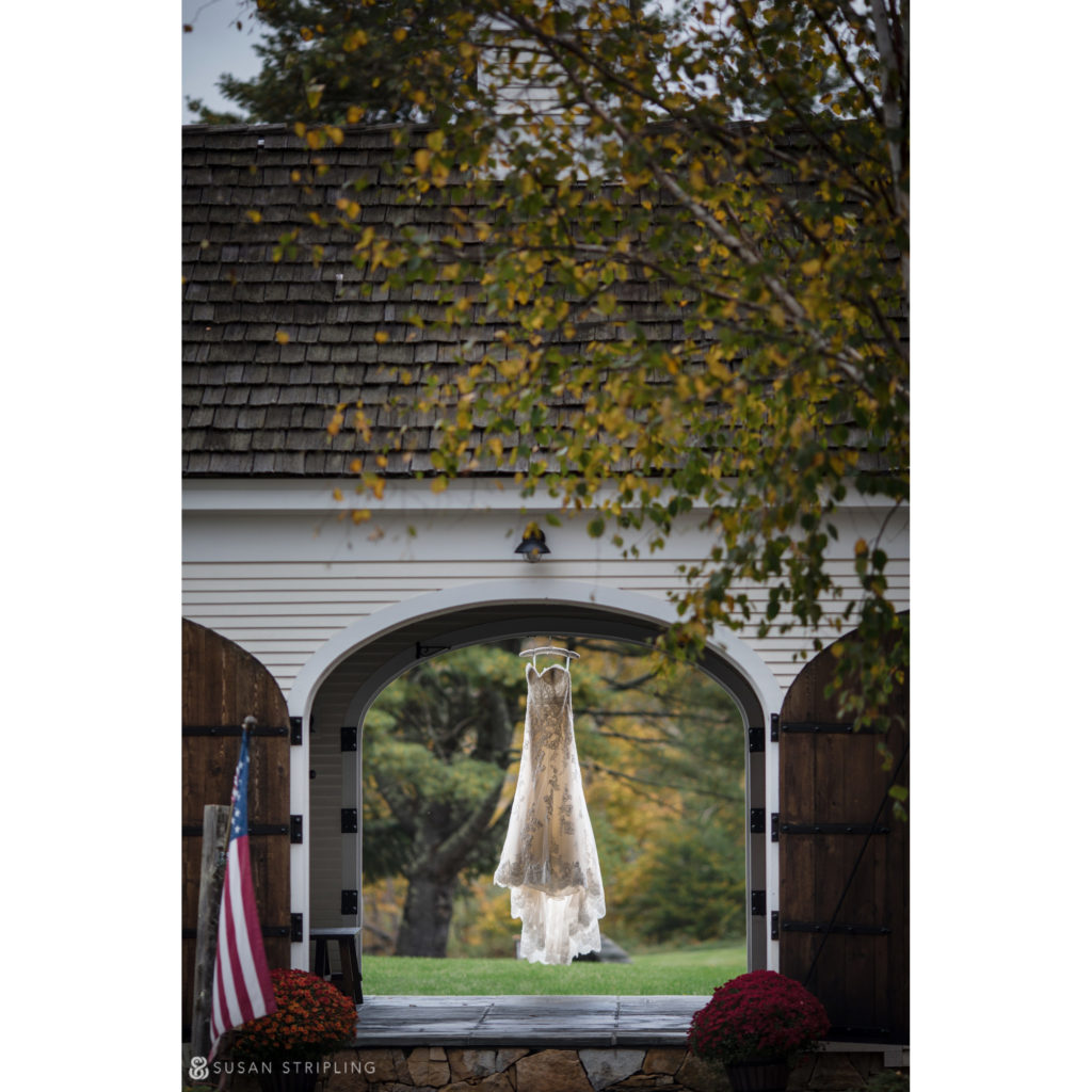 wedding dress at riverside farm hanging in the arches of the entrance