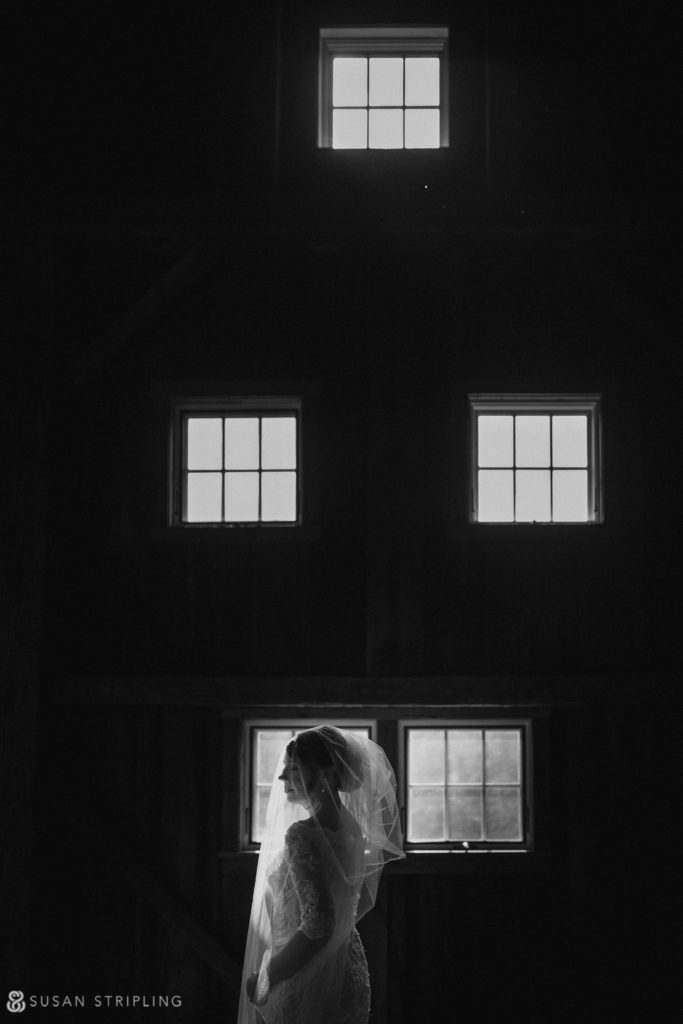 bride getting ready in the red barn riverside farm