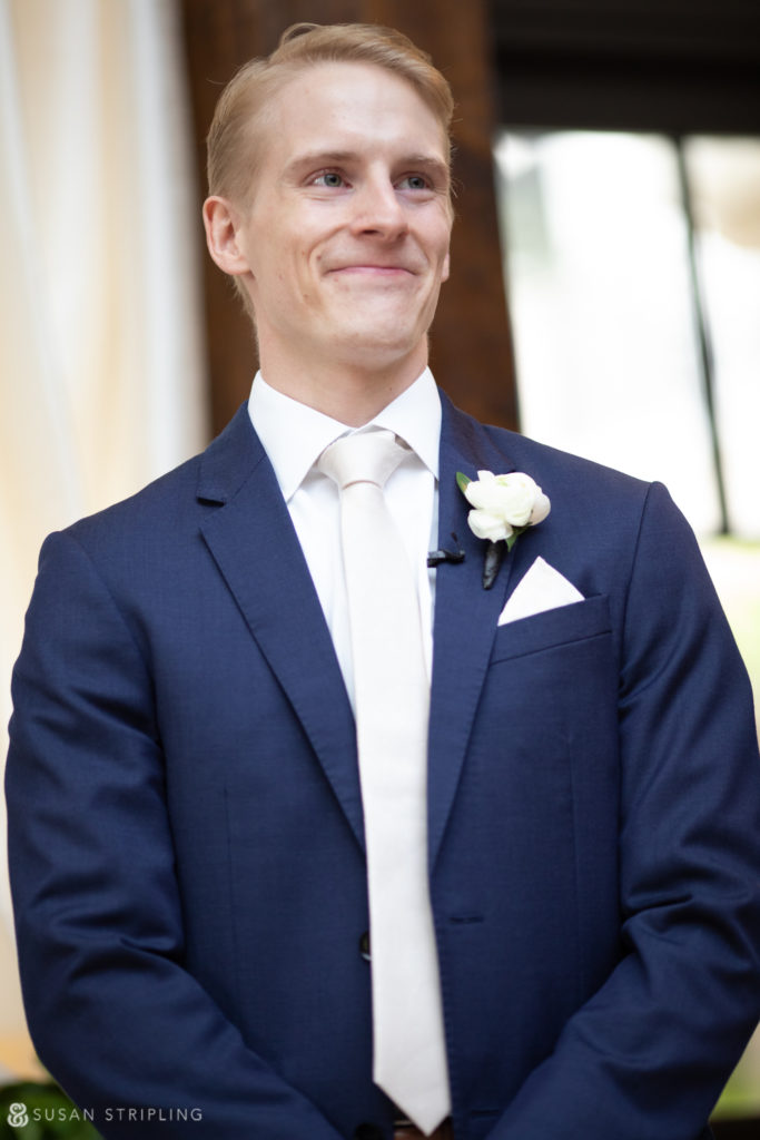 groom waiting for bride at the end of the aisle alfond inn wedding