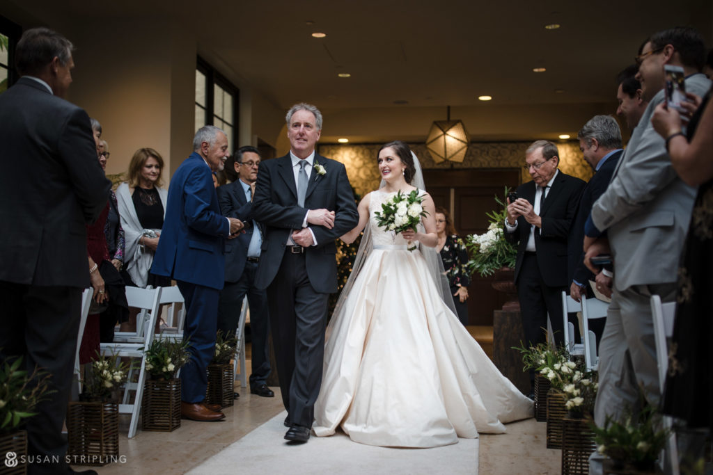 bride walking down aisle alfond inn wedding