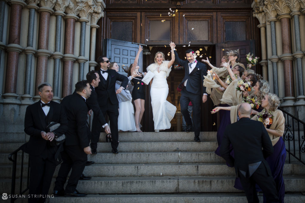 rose petal toss on church steps after wedding ceremony philly